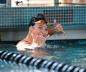 Valerie Tarazi, from Crystal Lake, reacts to her teammates after winning the 100 yard butterfly, during the Woodstock Swimming Invite at Woodstock North High School on Saturday, 9/16/17 in Woodstock, Illinois. John Konstantaras photo for Shaw Media