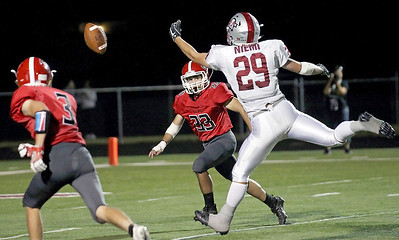 Candace H. Johnson-For Shaw Media Antioch's Cole Niemi reaches to catch a pass as Grant's Johnathon Osmon defends in the fourth quarter at Grant Community High School in Fox Lake.