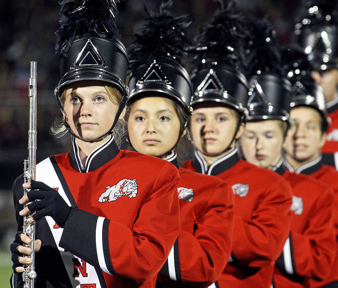Candace H. Johnson-For Shaw Media Grant's Hayley Copenhaver, 17, gets ready to play her flute with the Grant Marching Bulldogs at half-time during the varsity football game against Antioch at Grant Community High School in Fox Lake.