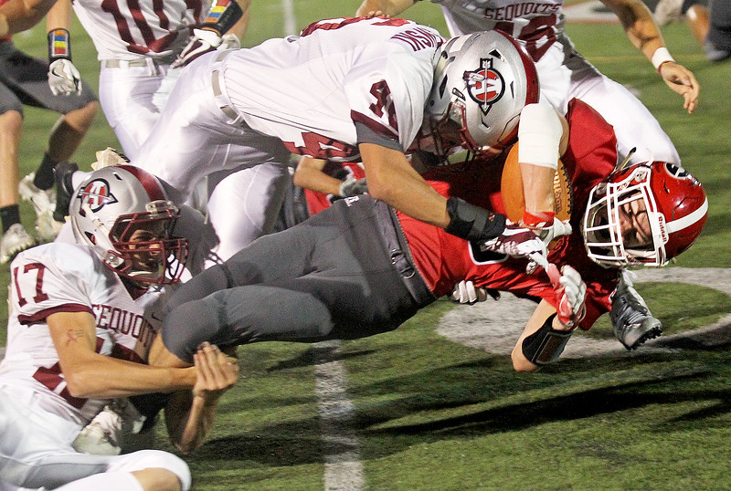 Candace H. Johnson-For Shaw Media Grant's Barrett Innes gets tackled by Antioch's Jay Brown and Liam Czaplewski in the first quarter at Grant Community High School in Fox Lake.