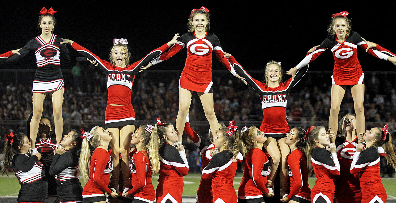 Candace H. Johnson-For Shaw Media Grant cheerleaders perform at half-time during the varsity football game against Antioch at Grant Community High School in Fox Lake.