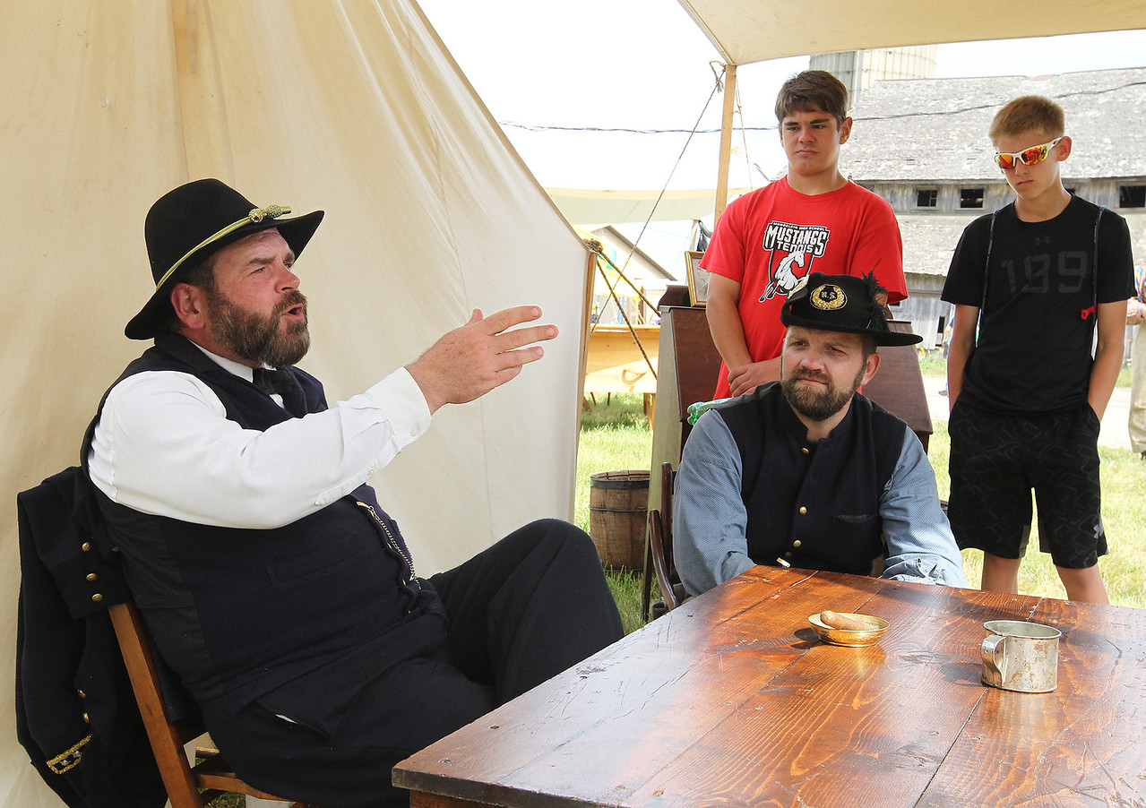 Candace H. Johnson-For Shaw Media Wayne Issleb, of Trevor, Wis., as General Ulysses S. Grant answers questions about fighting the Confederates during Hainesville's Civil War Encampment & Battle at the Northbrook Sports Club in Hainesville. Chris Holzman, of Fond du Lac, Wis., as the captain of the 36th Wisconsin infantry,  Lucas Nyberg and Jacob Perraud, both 15, of Mundelein listened to the general.