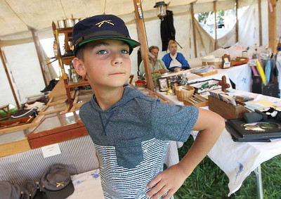 Candace H. Johnson-For Shaw Media Sava Vatistas, 9, of Round Lake Beach tries on a Union soldier kepi hat during Hainesville's Civil War Encampment & Battle at the Northbrook Sports Club in Hainesville. The hat was for sale in Allen's Laurel Hill Sutlery.