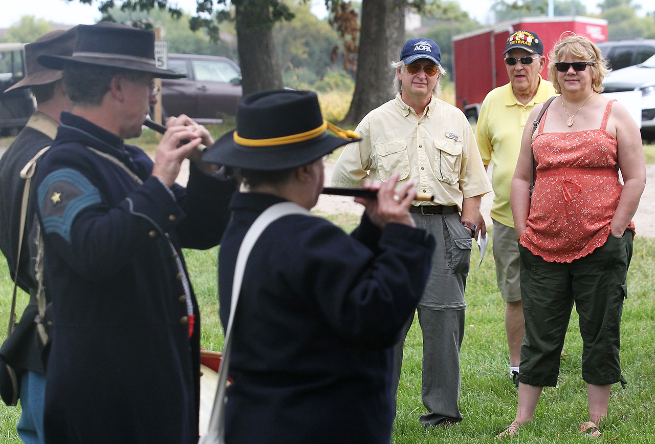 Candace H. Johnson-For Shaw Media Jim Nelson, of Lake Villa, Ken Parrish, of Hainesville and Donna Warner, of Lake Villa listen to a Fife & Drum concert during Hainesville's Civil War Encampment & Battle at the Northbrook Sports Club in Hainesville.