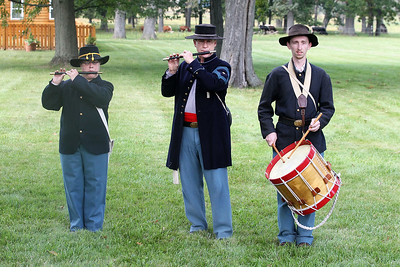 Candace H. Johnson-For Shaw Media Laura Roegner, of Lombard, Dr. Steve Smunt, of St. Charles, and Kevin Skalak, of Westchester, as 1st Illinois Battalion field musicians perform a Fife & Drum concert during Hainesville's Civil War Encampment & Battle at the Northbrook Sports Club in Hainesville.