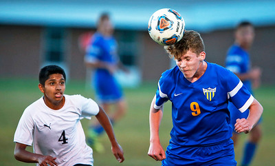 John Konstantaras - for Shaw Media Timothy Conner (9) from Johnsburg heads a ball in front of Daniel Robles Ibarra (4) from Harvard during the first half of their game on Tuesday, September 19, 2017 in Harvard, Illinois. The Hornets defeated the Skyhawks 1-0.