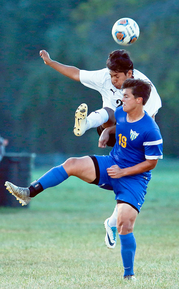 John Konstantaras - for Shaw Media Carlos Nova (24) from Harvard kicks a ball over Mj Alvarez (19) from Johnsburg during the first half of their game on Tuesday, September 19, 2017 in Harvard, Illinois. The Hornets defeated the Skyhawks 1-0.