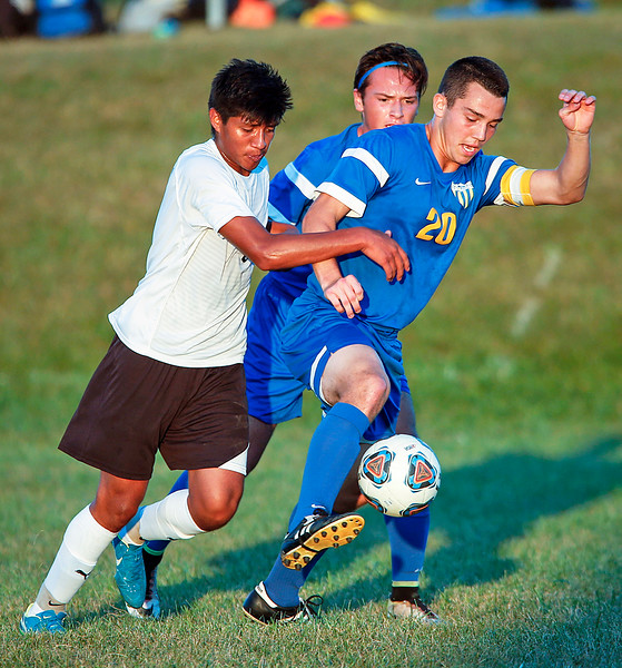 John Konstantaras - for Shaw Media Will Conroy (20) from Johnsburg works the ball around Noe Hernandez Reynoso (6) from Harvard during the first half of their game on Tuesday, September 19, 2017 in Harvard, Illinois. The Hornets defeated the Skyhawks 1-0.