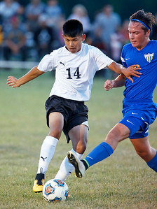 John Konstantaras - for Shaw Media Brayan A. Sanchez (14) from Harvard and Cody Dschida (2) from Johnsburg battle for a ball during the first half of their game on Tuesday, September 19, 2017 in Harvard, Illinois. The Hornets defeated the Skyhawks 1-0.