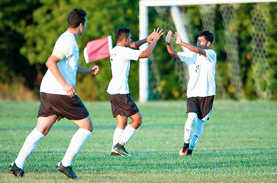 John Konstantaras - for Shaw Media Alexis Robles (center) from Harvard celebrates his goal with Marcos Cabrera (3) during the first half of their game on Tuesday, September 19, 2017 in Harvard, Illinois. The Hornets defeated the Skyhawks 1-0.