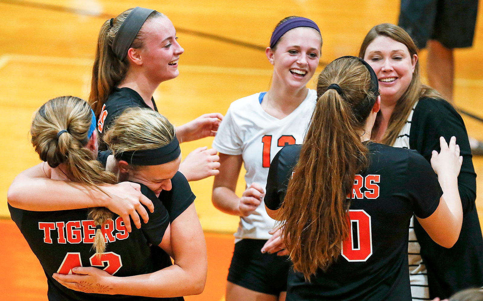 Madde Blake (35) from Crystal Lake Central hugs Megan Kelly (42) from Crystal Lake Central after they beat Huntley in 2 games at Crystal Lake Central High School on Thursday, September 21, 2017 in Crystal Lake, Illinois. The Tigers won the set in 2 games; 25-20, 25-23. John Konstantaras photo for Shaw Media