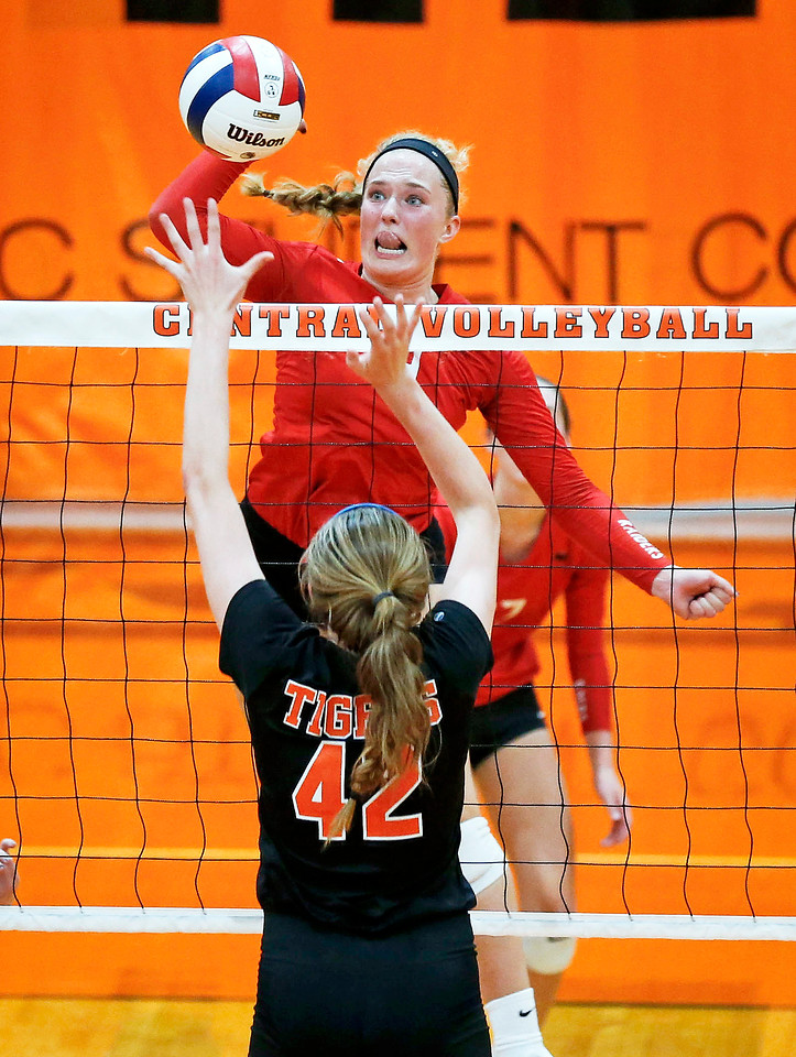 Loren Alberts (19) from Huntley goes above the net for a ball over Megan Kelly (42) from Crystal Lake Central during their second game at Crystal Lake Central High School on Thursday, September 21, 2017 in Crystal Lake, Illinois. The Tigers won the set in 2 games; 25-20, 25-23. John Konstantaras photo for Shaw Media