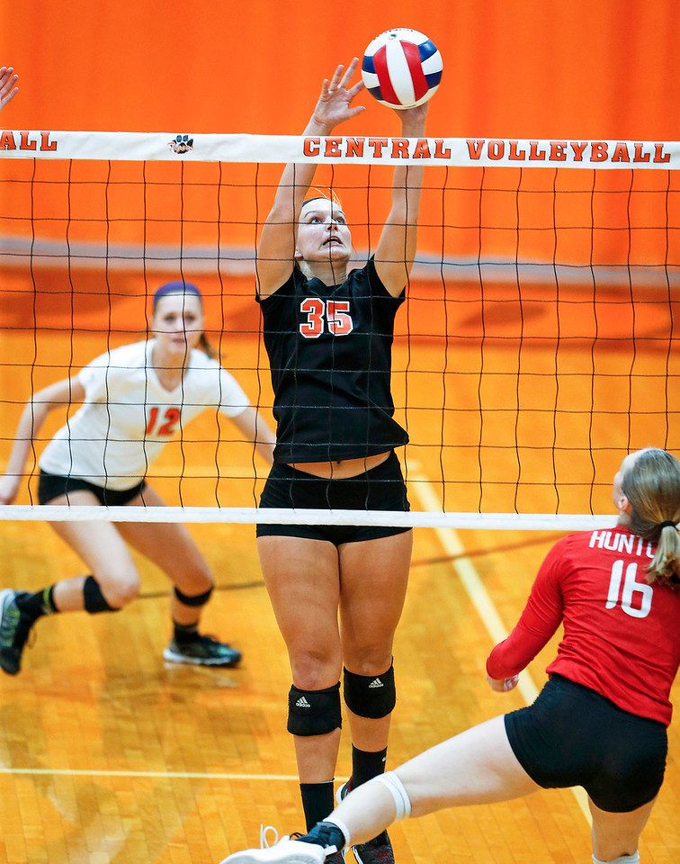Madde Blake (35) from Crystal Lake Central blocks a ball hit by Aleah Amelio (16) from Huntley during their first game at Crystal Lake Central High School on Thursday, September 21, 2017 in Crystal Lake, Illinois. The Tigers won the set in 2 games; 25-20, 25-23. John Konstantaras photo for Shaw Media