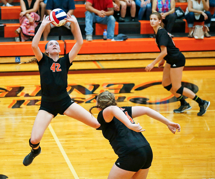 Megan Kelly (42) from Crystal Lake Central sets a ball during their first game against Huntley at Crystal Lake Central High School on Thursday, September 21, 2017 in Crystal Lake, Illinois. The Tigers won the set in 2 games; 25-20, 25-23. John Konstantaras photo for Shaw Media