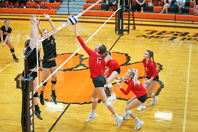 Emma Konie (17) from Huntley tips a ball over the net during their second game against  Crystal Lake Central on Thursday, September 21, 2017 in Crystal Lake, Illinois. The Tigers won the set in 2 games; 25-20, 25-23. John Konstantaras photo for Shaw Media