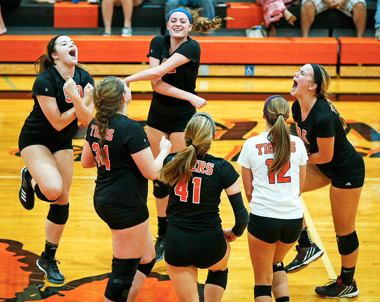 Crystal Lake Central players celebrate game point during their first game Huntley at Crystal Lake Central High School on Thursday, September 21, 2017 in Crystal Lake, Illinois. The Tigers won the set in 2 games; 25-20, 25-23. John Konstantaras photo for Shaw Media