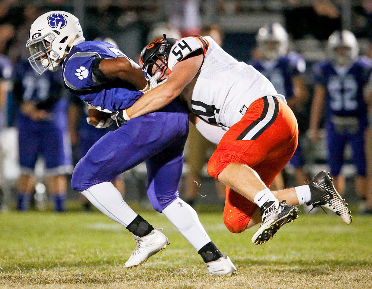 Trevone Woods (31) from Hampshire is tackled for a loss by Cade Keenan (54) from Crystal Lake Central during the second quarter of their game on Friday, September 22, 2017, in Hampshire, Illinois. John Konstantaras photo for Shaw Media