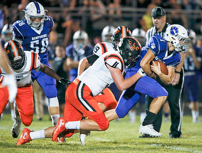 Benjamin Corcelles (7) from Hampshire is tackled by Zacary Batterham (11) from Crystal Lake Central as he runs for a first down during the first quarter of their game on Friday, September 22, 2017, in Hampshire, Illinois. John Konstantaras photo for Shaw Media