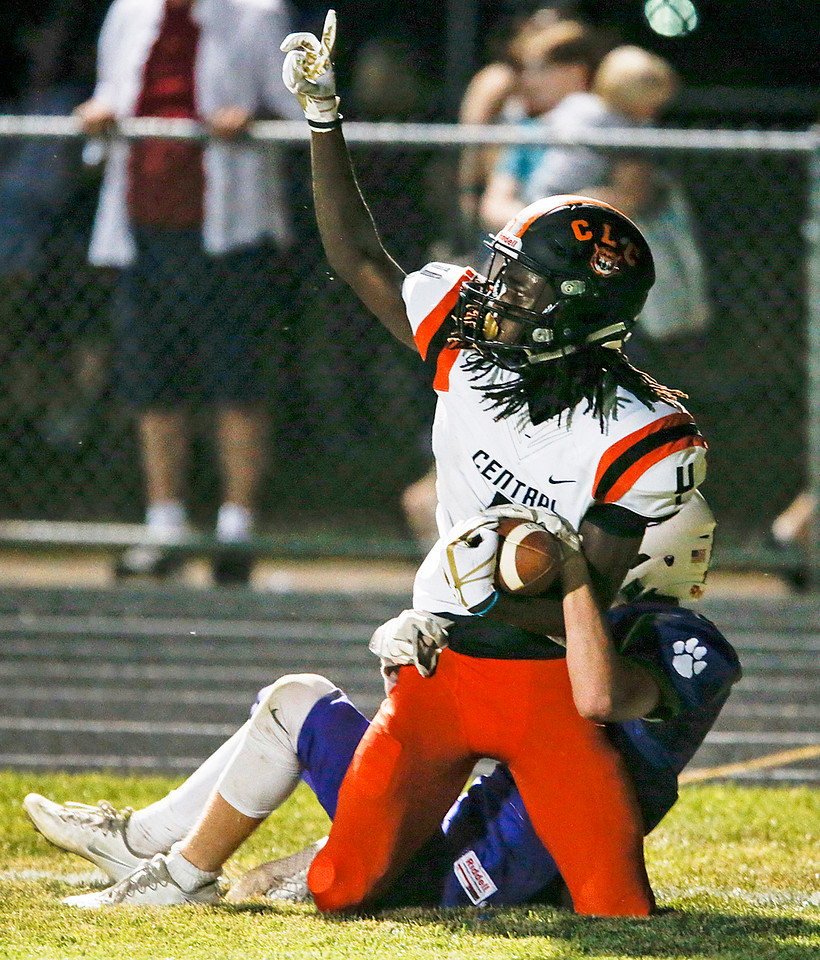 Daniel Manning (4) from Crystal Lake Central celebrates his touchdown as Cameron Fleury (2) from Hampshire hangs on during the second quarter of their game on Friday, September 22, 2017, in Hampshire, Illinois. John Konstantaras photo for Shaw Media