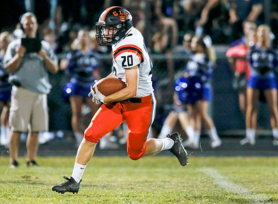 Cade Gau (20) from Crystal Lake Central runs for a touchdown during the first quarter of their game against Hampshire on Friday, September 22, 2017, in Hampshire, Illinois. John Konstantaras photo for Shaw Media