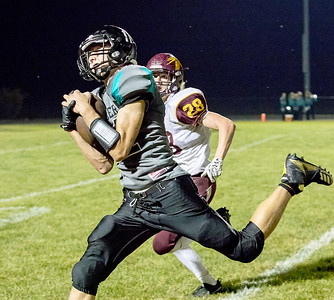 Woodstock North High School receiver Joseph Grover hauls in a pass on the sideline Friday, September 22, 2017 against Richmond-Burton in Woodstock. Woodstock North goes on for the big conference win 35-3.  KKoontz- For Shaw Media