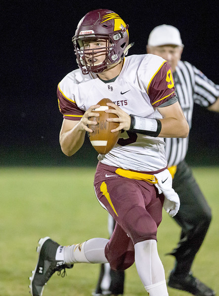 Richmond-Burton High School quarterback Luke Uhwat is chased out of the pocket Friday, September 22, 2017 against Woodstock North in Woodstock. Woodstock North wins big 35-3. KKoontz – For Shaw Media