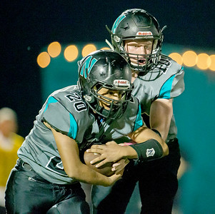 Woodstock North High School quarterback Collin Mergl (10) hands the ball to running back Alejandro Perez (20) in the first quarter Friday, September 22, 2017 against Richmond-Burton in Woodstock. Woodstock North gets the big conference win 35-3. KKoontz- For Shaw Media