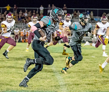 Woodstock North High School quarterback Collin Mergl turns the corner and runs for another first down Friday, September 22, 2017 against Richmond-Burton in Woodstock. Woodstock North goes on for the big conference win 35-3.  KKoontz- For Shaw Media