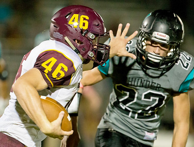 Richmond-Burton High School running-back Mike Kaufman (46) tries to find some running room against Woodstock North defender Zachary Stopczynski (22) in the second quarter Friday, September 22, 2017 in Woodstock. Woodstock North goes on to win 35-3. KKoontz – For Shaw Media