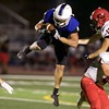 St. Charles North's Lucas Segobiano intercepts the throw from Glenbard East on Sept. 22 in St. Charles. St. Charles North won the game 38-6.