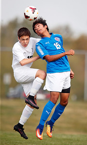 Jonathan Walls (17) from Prairie Ridge and Ivan Juanchi (15) from Dundee-Crown battle for a header during the first half of their game at Prairie Ridge High School on Tuesday, September 26, 2017, in Crystal Lake, Illinois. The Chargers defeated the Wolves 1-0 in overtime. John Konstantaras photo for Shaw Media