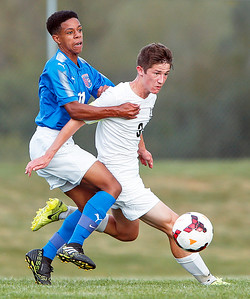Kevin Juanchi (17) from Dundee-Crown holds onto Matthew King (3) from Prairie Ridge during the first half of their game at Prairie Ridge High School on Tuesday, September 26, 2017, in Crystal Lake, Illinois. The Chargers defeated the Wolves 1-0 in overtime. John Konstantaras photo for Shaw Media