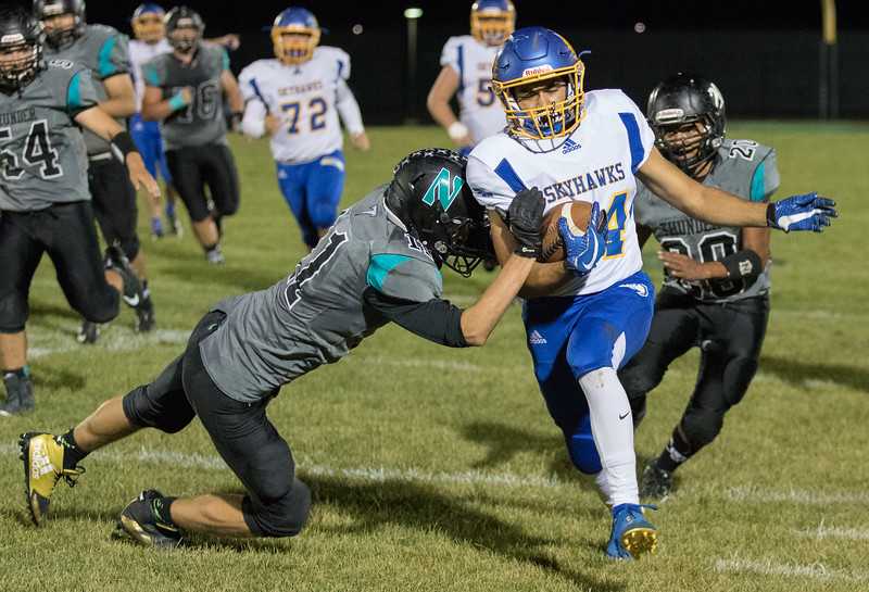 Johnsburg receiver Nico LoDolce makes the catch and is driven out of bounds by Woodstock North's Joseph Grover late in the second quarter Friday, September 29, 2017 at Woodstock North High School. Johnsburg goes on to win the conference matchup 41-7. KKoontz – For Shaw Media