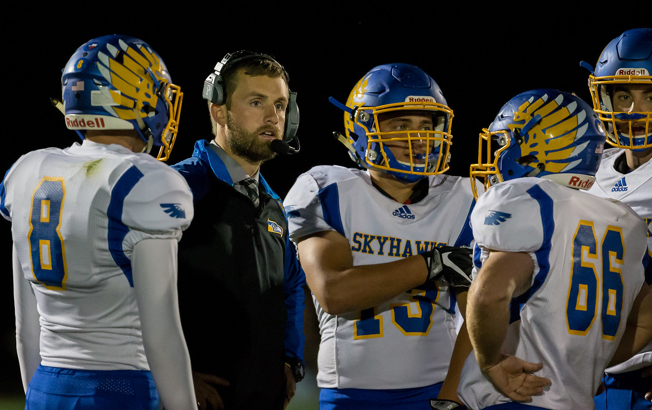 Johnsburg High School football Head Coach Dan DeBoeuf talks to the team during a timeout Friday, September 29, 2017 at Woodstock North High School. Johnsburg goes on to win the conference matchup 41-7. KKoontz – For Shaw Media