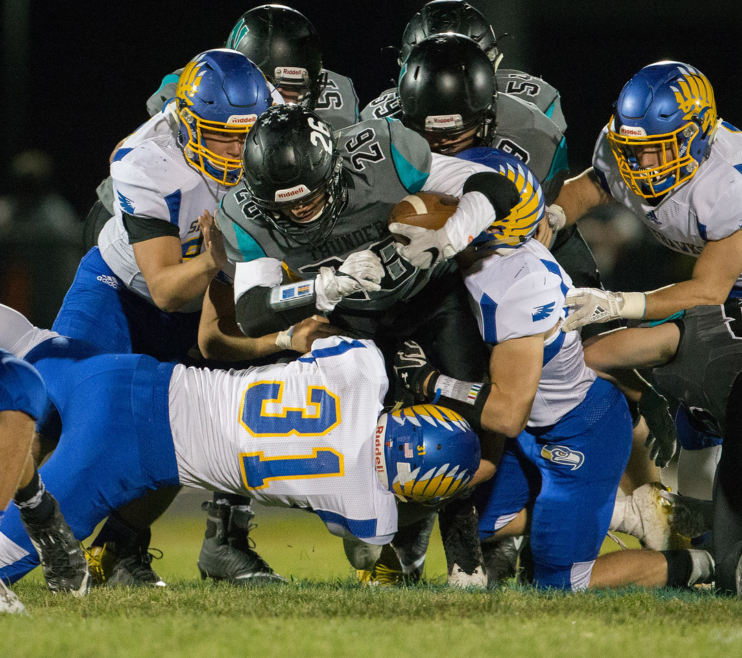 Johnsburg's defense smothers Woodstock North's Ed Flores Friday, September 29, 2017 at Woodstock North High School. Johnsburg goes on to win the conference matchup 41-7. KKoontz – For Shaw Media