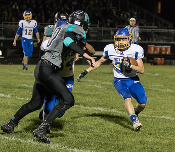 Johnsburg's Jesse Mercado makes the catch and waits for the block Friday, September 29, 2017 at Woodstock North High School. Johnsburg goes on to win the conference matchup 41-7. KKoontz – For Shaw Media
