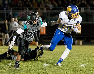 Johnsburg's Brody Frazier breaks away from Woodstock North's Ed Flores Friday, September 29, 2017 at Woodstock North High School. Johnsburg goes on to win the conference matchup 41-7. KKoontz – For Shaw Media