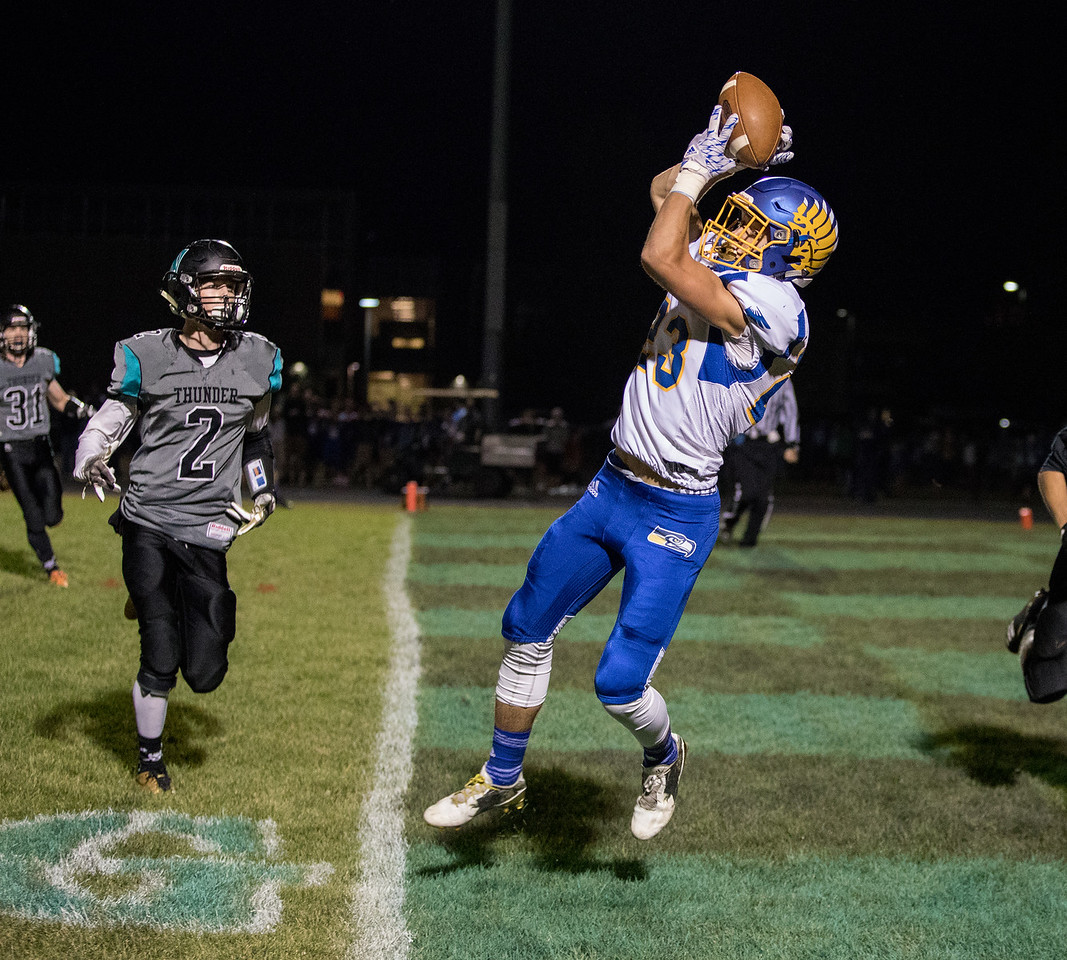 Johnsburg High School receiver Brody Frazier catches the first of his three first-half touchdowns Friday, September 29, 2017 at Woodstock North High School. Johnsburg goes on to win the conference matchup 41-7. KKoontz – For Shaw Media