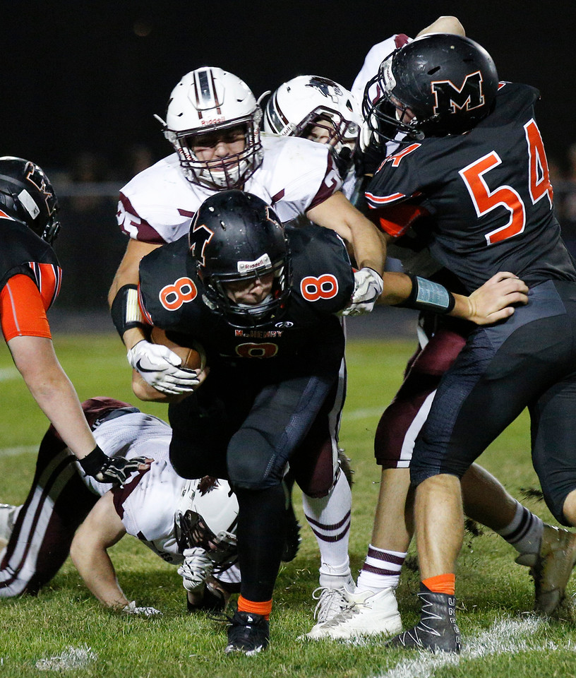 Quarterback Patrick Breisch (8) form McHenry is sacked by Jacob Ommen (25) from Prairie Ridge during their game at McHenry High School on Friday, September 29, 2017 in McHenry, Illinois. John Konstantaras photo for Shaw Media
