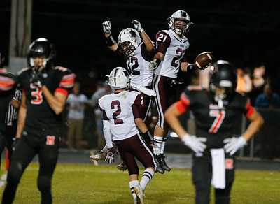 F. Joseph Perhats (21) from Prairie Ridge celebrates his touchdown with Zach Gulbransen (32) during the second quarter of their game at McHenry High School on Friday, September 29, 2017 in McHenry, Illinois. John Konstantaras photo for Shaw Media