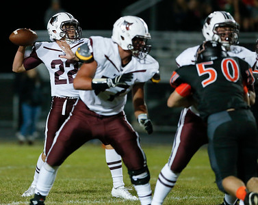 Samson Evans (22) from Prairie Ridge throws a touchdown pass during the first quarter of their game against McHenry on Friday, September 29, 2017 in McHenry, Illinois. John Konstantaras photo for Shaw Media