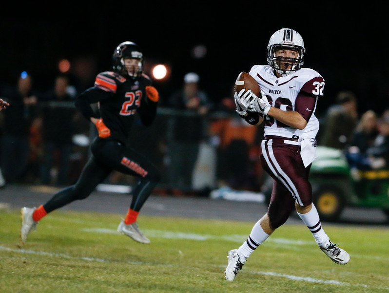 Zach Gulbransen (32) from Prairie Ridge catches a touchdown pass during the first quarter of their game against McHenry on Friday, September 29, 2017 in McHenry, Illinois. John Konstantaras photo for Shaw Media