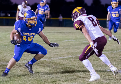Johnsburg High School receiver Austin Lichtenstein makes the catch and then turns up-field against conference rival Richmond-Burton Friday, September 8, 2017 at Johnsburg High School in Johnsburg. Johnsburg goes on to win 34-10. KKoontz- For Shaw Media