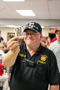 Commander Dwane Lungren holds the card of contestant 29, a queen of clubs.