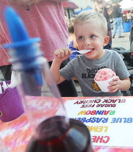 Candace H. Johnson-For Shaw Media Dylan Kurz, 3, of Wauconda enjoys a My Flavor It! Place shaved ice during Wauconda's 19th Annual Street Dance on Main Street in Wauconda. Dylan was at the street dance event with his father, Dennis.