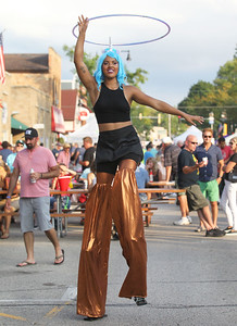 Candace H. Johnson-For Shaw Media Stilt walker Radiance Campbell, of Bloomington, with the Illinois State University Circus Performers, entertains the crowd during Wauconda's 19th Annual Street Dance on Main Street in Wauconda.