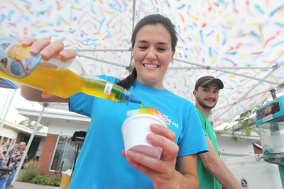 Candace H. Johnson-For Shaw Media Cally Raves, of Wauconda, with My Flavor It! Place makes rainbow shaved ice for a customer with her husband, Chris Hamel, by her side during Wauconda's 19th Annual Street Dance on Main Street in Wauconda.