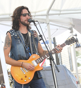 """Candace H. Johnson-For Shaw Media Lead vocalist Nick Bell with the Nick Bell Band, a blues and rock band, sings the song,""""Mule,"""" during Wauconda's 19th Annual Street Dance on Main Street in Wauconda."""