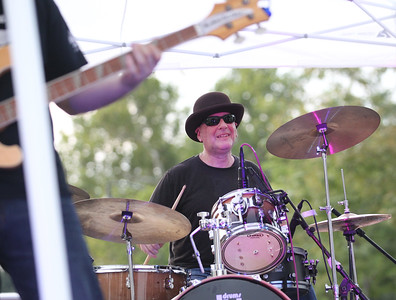 Candace H. Johnson-For Shaw Media Jon Hard, of Island Lake, with the blues/rock band, The Riverside Prowlers, plays his drums during Wauconda's 19th Annual Street Dance on Main Street in Wauconda.