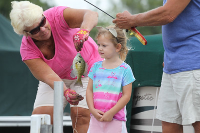 Candace H. Johnson-For Shaw Media Jean and Ron Schindler, of Wauconda help their granddaughter, Riley Swanson, 3, of Lisle measure the bluegill fish she just caught fishing on a pier during the 13th Annual Kids Fishing Derby in Bangs Lake in Wauconda. The event was hosted by Wauconda Boat and sponsored by the Bangs Lake Advisory Committee. (9/2/18)